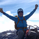 Carol Masheter on the summit of Carstensz Pyramid